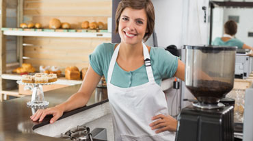 Smiling female bakery owner